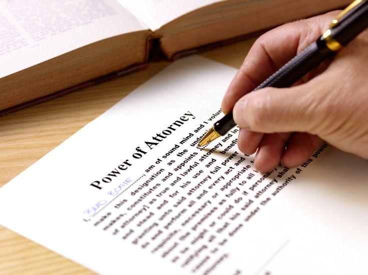 Person signing an enduring power of attorney legal document