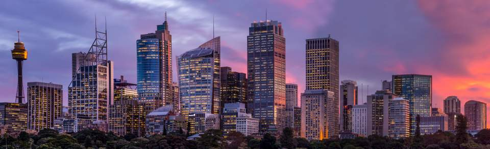 Sydney property market; city skyscrapers panoramic view, sunset
